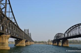 Sino-Korean Friendship Bridge And Broken Bridge From A Boat