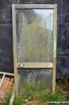 Grime-Stained Glass Door
