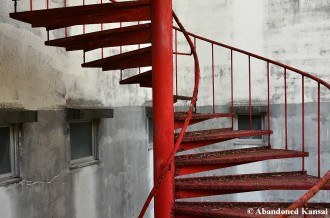 Rusty Red Spiral Staircase