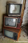 Stacked Abandoned TVs