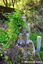 Overgrown Monk Statue