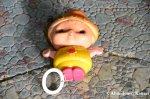 Left-Behind Plastic Doll