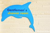 Gentlemen's Shower Room Sign In The Shape Of A Dolphin