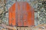 Rusty Locked And Welded Shut Mine EntranceDoor