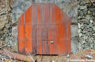 Rusty Locked And Welded Shut Mine Entrance Door