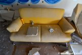 Abandoned Yellow Hotel Couch