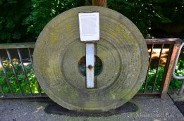 old-millstone-with-info-sign
