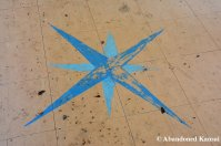 Blue Compass Rose In An Abandoned School
