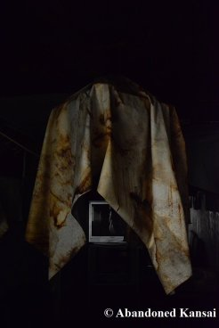 Peeling Wallpaper Over Chandelier