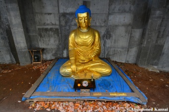 Abandoned Golden Buddha Statue