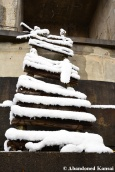 Snow-Covered Wooden Ladder