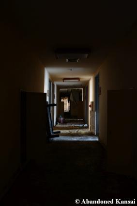 spooky abandoned hotel hallway