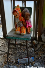 Abandoned Dolls On A Chair