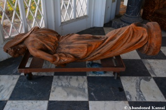 Abandoned Wooden Statue